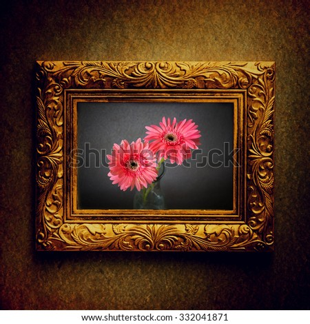 Vintage photo frame with image of flowers over grunge background - stock photo