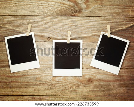 Vintage photo frames on the wooden board background with space for your text