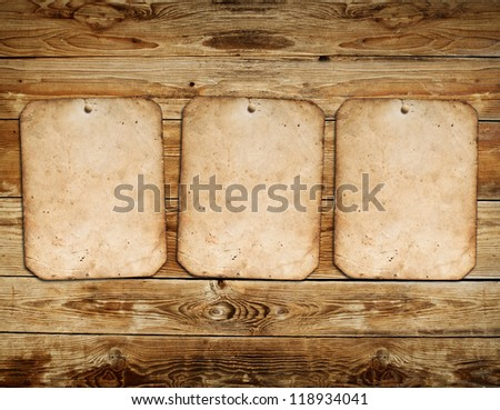 Vintage photo frames on wood background - stock photo
