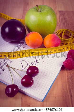 Vintage photo, Fresh fruits and tape measure with notebook for writing notes, concept of slimming, diet and healthy nutrition - stock photo