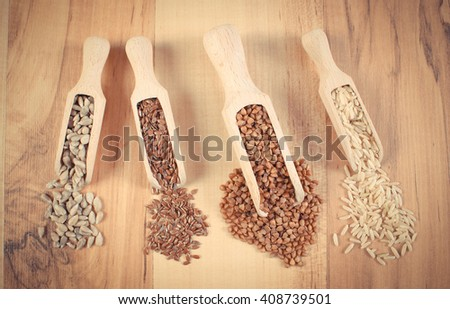 Vintage photo, Fresh, natural ingredients and products containing magnesium and dietary fiber, healthy food and nutrition, brown rice, buckwheat, linseed, sunflower - stock photo