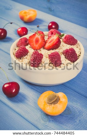 Vintage photo, Fresh prepared oat flakes and oatmeal with fruits in glass bowl, concept of diet, healthy lifestyles and nutrition
