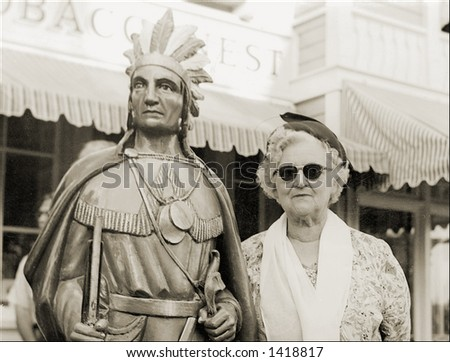 Vintage photo of a Cigar Store Indian With an Old Lady - stock photo