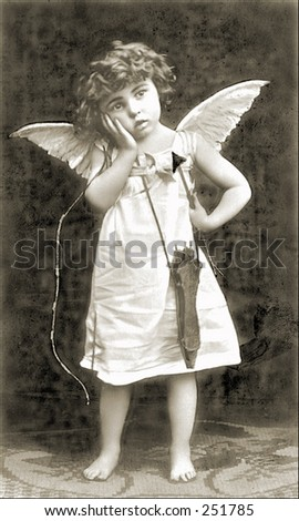 Vintage Photo of a Cupid With Bow And Arrow - stock photo