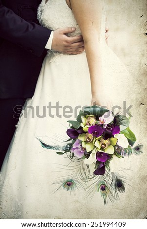 Vintage photo of a groom and a bride holding a wedding bouquet - stock photo