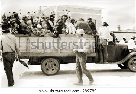 Vintage photo of a Group of Indians in Truck bed - stock photo