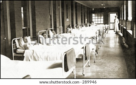 Vintage photo of a Hospital Hallway Lined With Men In Beds - stock photo