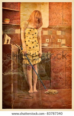 Vintage photo of a housewife, with iron, vacuum cleaner, and cleaning broom standing in the kitchen. - stock photo