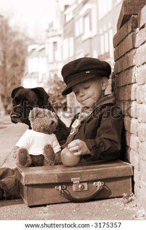 Vintage photo of a little boy and his dog - stock photo