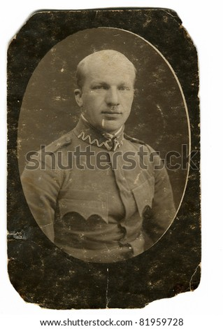 Vintage photo of a man in uniform (thirties) - stock photo