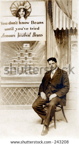 Vintage Photo of a Man Posing With Bean Advertisement - stock photo