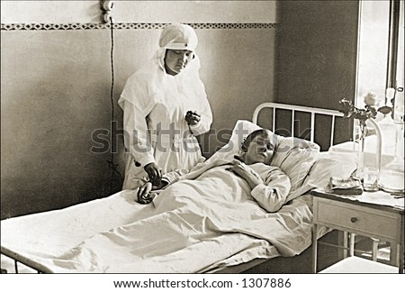 Vintage photo of a Nurse Checking Patients Vital Signs - stock photo