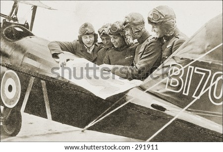 Vintage photo of a Pilots Poring Over Flight Plan - stock photo