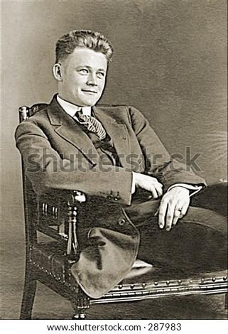 Vintage photo of a Youthful Executive Smirking - stock photo