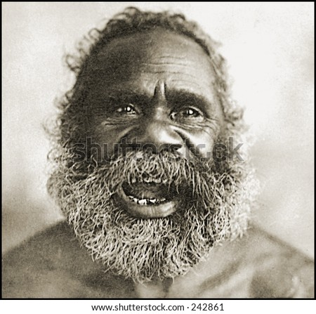 Vintage Photo of an Ancient Aborigine Man Laughing - stock photo