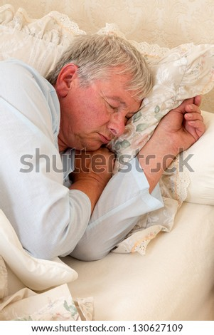 Vintage photo of an elderly man sleeping - stock photo