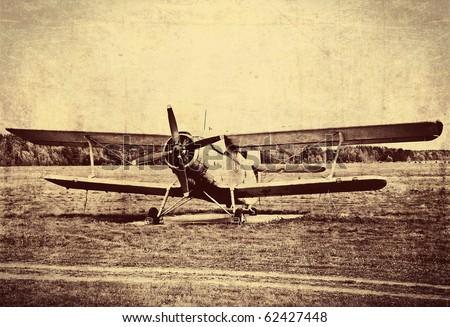 Vintage photo of an old biplane - stock photo