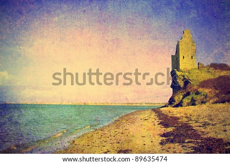 vintage photo of ancient tower ruins on the sea shore in scotland - stock photo