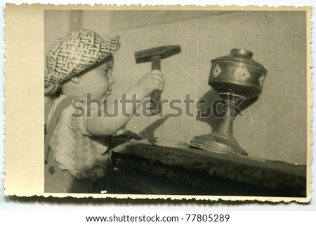 Vintage photo of baby boy (early forties) - stock photo