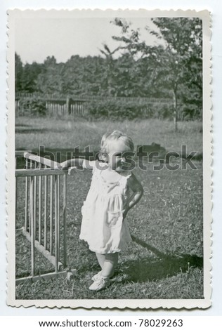 Vintage photo of baby girl (early fifties) - stock photo