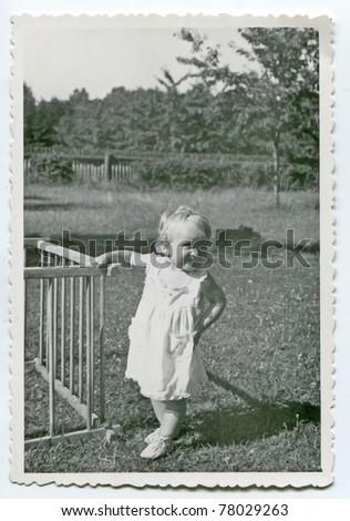 Vintage photo of baby girl (early fifties) - stock photo