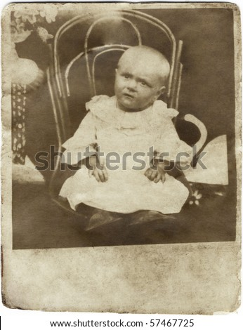 Vintage photo of baby. Russia, The beginning of 20 century. - stock photo
