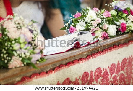Vintage photo of beautiful flowers wedding decoration in a church - stock photo