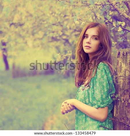 Vintage photo of beautiful girl in spring - stock photo