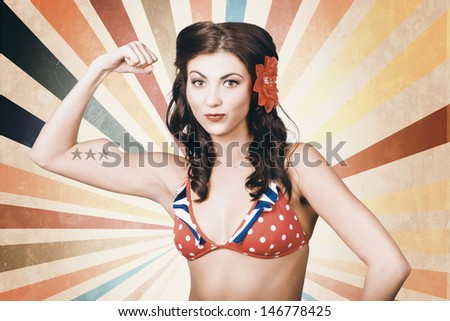 Vintage photo of beautiful pinup girl with american star tattoo showing the power of womens rights when flexing muscles in retro fashion style - stock photo