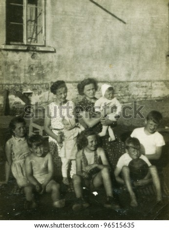 Vintage photo of big family (fifties) - stock photo