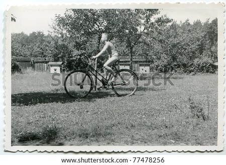 Vintage photo of boy cycling (fifties) - stock photo