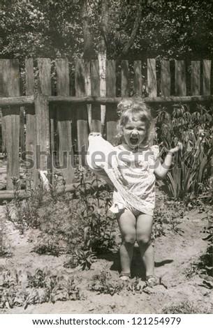 Vintage photo of boy (fifties) - stock photo