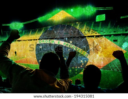 Vintage photo of Brazil flag and silhouette of supporters in stadium - stock photo