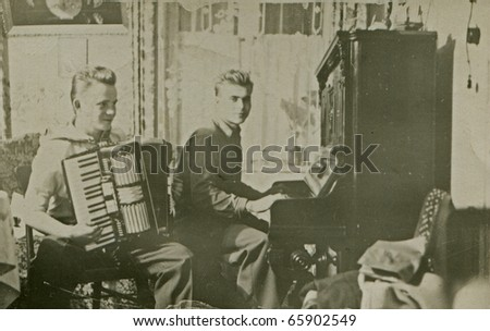 Vintage photo of brothers playing music (forties) - stock photo