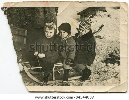 Vintage photo of children on sled (fifties)