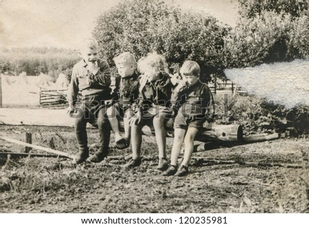 Vintage photo of children outdoor (fifties) - stock photo