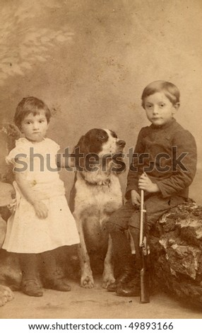 Vintage photo of children with a dog (circa 1893) - stock photo