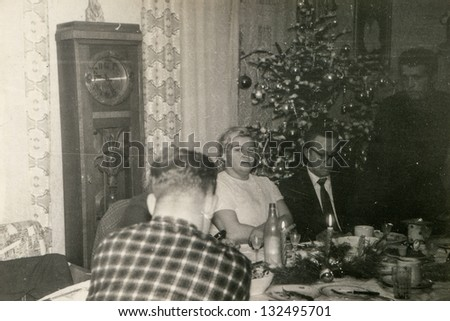 Vintage photo of Christmas party (seventies) - stock photo
