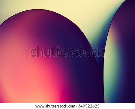 Vintage photo of colorful paper abstraction made with curved paper sheets and colorful lights.   - stock photo
