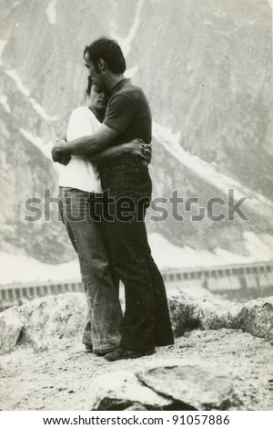 Vintage photo of couple (early seventies) - stock photo