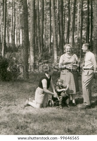 Vintage photo of couple, son and daughter - fifties - stock photo