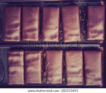 Vintage photo of delicious chocolate pralines in the box - stock photo