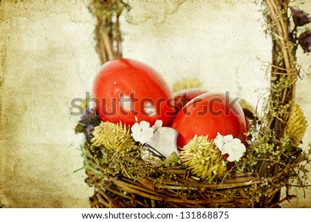 Vintage photo of Easter eggs in basket - stock photo