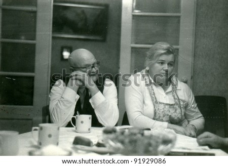 Vintage photo of elderly father and adult daughter (fifties) - stock photo