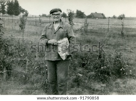Vintage photo of elderly peasant (sixties) - stock photo