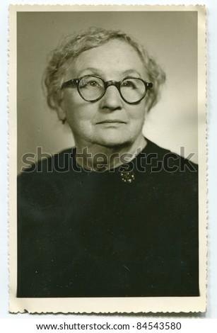 Vintage photo of elderly woman (fifties) - stock photo