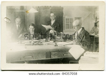 Vintage photo of employees in accounting office (thirties)