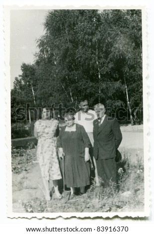 Vintage photo of family (fifties) - stock photo