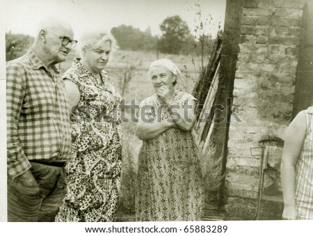 Vintage photo of family in farm