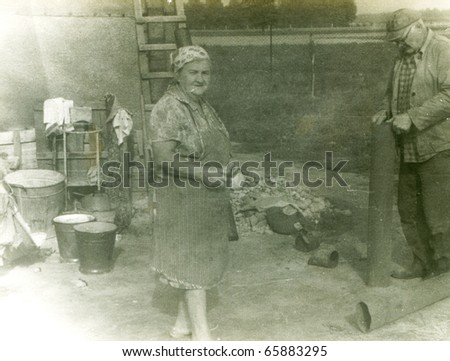 Vintage photo of family in farm - stock photo